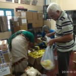 Samajam flood relief materials packing 2